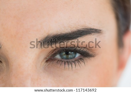 Close-up of woman with blue eyes - stock photo