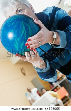 Close up of woman with bowling ball - stock photo