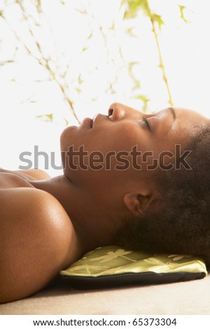 Close up of woman with eyes closed - stock photo