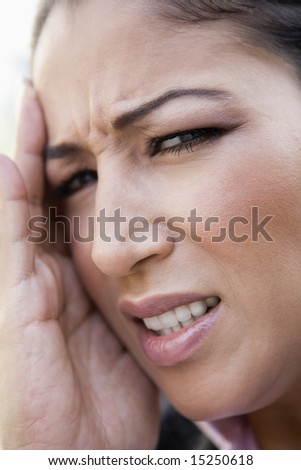 Close up of woman with headache holding head - stock photo