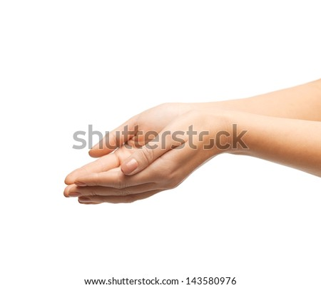 close up of womans cupped hands showing something