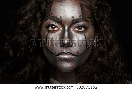 close up of women face with silver paint makeup