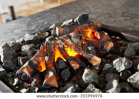 Close Up Of Wooden Bonfire For Barbecue In A Luxury Restaurant