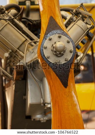 Close up of wooden carved propeller from antique engine of aircraft
