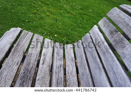 Close up of wooden chair in the garden - stock photo