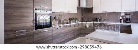 Close-up of wooden cupboards in cozy kitchen - stock photo