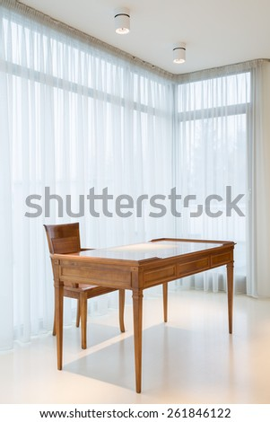 Close-up of wooden desk in designed house - stock photo