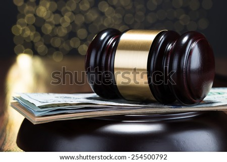 Close-up Of Wooden Gavel On A Banknote - stock photo