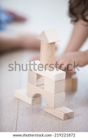 Close-up of wooden tower on hardwood floor - stock photo