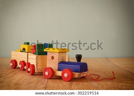 close up of Wooden toy train over wooden table. selective focus