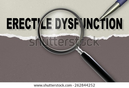 Close-up of word erectile dysfunction with pen and  magnifying glass on it - stock photo