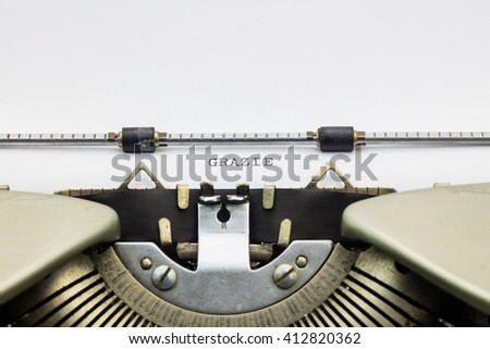 Close-up of word Grazie on typewriter sheet - stock photo