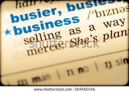 Close-up of word in English dictionary. Business, definition and transcription