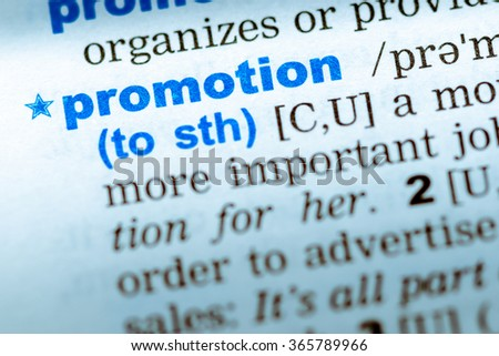 Close-up of word in English dictionary. Promotion, definition and transcription