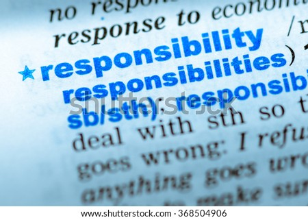 Close-up of word in English dictionary. Responsibility, definition and transcription