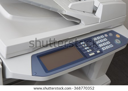 Close-up of working printer scanner copier device