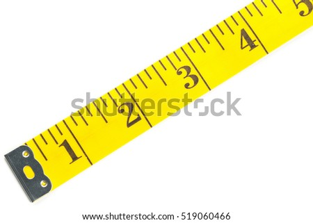 Close up of yellow measurement tape over white background