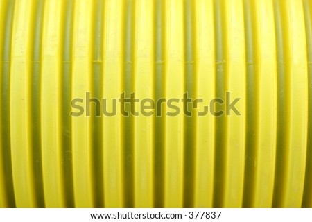 close up of yellow pipe - stock photo