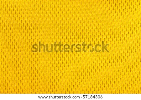 Close up of yellow polyester nylon yellow  sportswear shorts to created a textured background. - stock photo