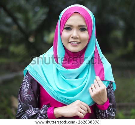 Close up of young beautiful Asian muslim woman wearing hijab. - stock photo