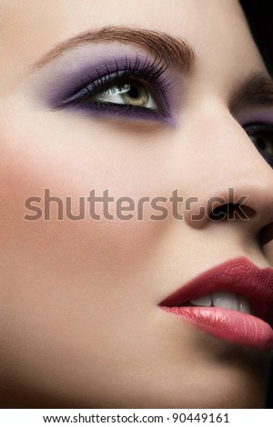 Close-up of young beautiful woman face with stylish make-up - stock photo
