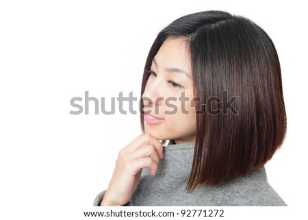 Close up of young beauty face with smile isolated on white background, model is a asian beauty - stock photo