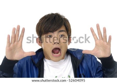 Close-up of young boy holding hands beside his cheeks and shouts an announcement. - stock photo
