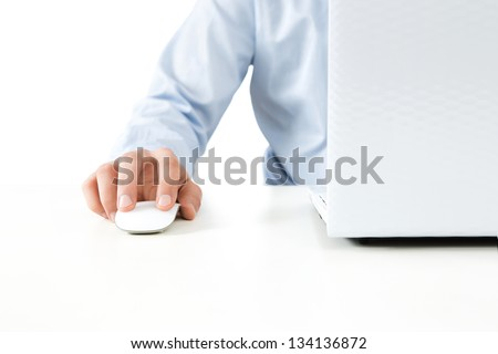 Close up of young businessman working on a laptop isolated on white background - stock photo