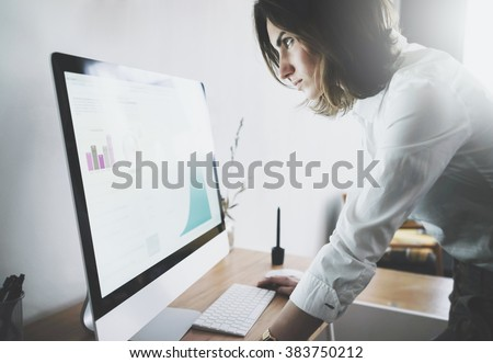 Close up of young businesswoman in white shirt looking at computer with the accounting report of the finance, woman working at her office with technology achievement research strategy concept - stock photo