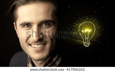 Close-up of young confident man with drawn light bulb - stock photo