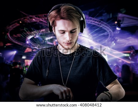 Close-up of young dj playing music in club - stock photo