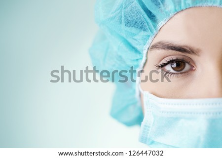 Close-up of young doctor - stock photo