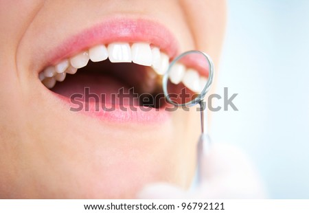 Close-up of young female having her teeth examinated