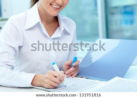 Close-up of young female writing proficiency test - stock photo