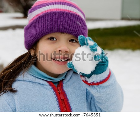 Close-up of Young Girl showing her Snowball. - stock photo