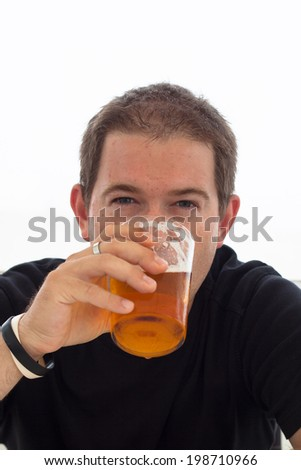 Close up of young man drinking beer. - stock photo
