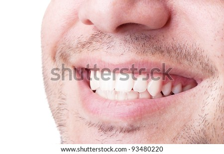 Close-up of young man smiling against white background