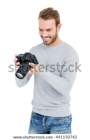 Close-up of young man using camera on white background