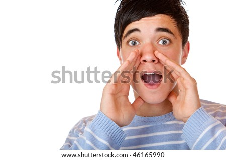 Close-up of young teenager holding hands beside his cheeks, shouts and looks surprised. Isolated on white. - stock photo