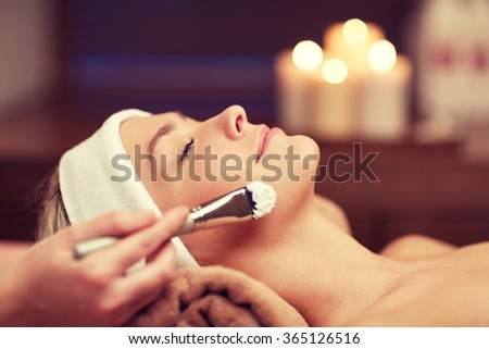 close up of young woman and cosmetologist in spa - stock photo
