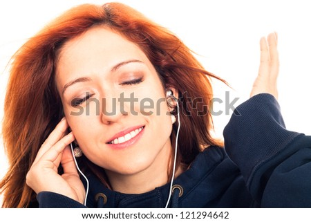 Close up of young woman enjoying listening music, isolated on white background. - stock photo