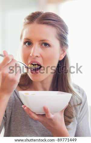 Close up of young woman having cereals