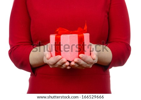Close-up of young woman in red dress giving the present with red - stock photo