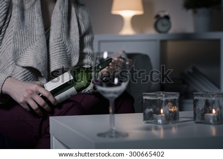 Close-up of young woman opening the wine - stock photo