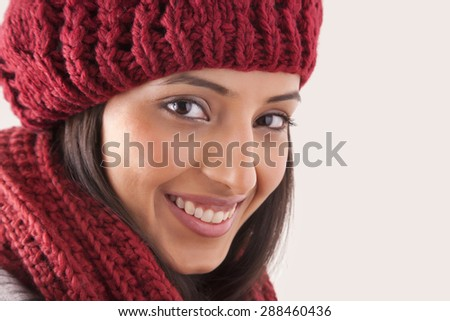Close-up of young woman wearing woolen hat - stock photo