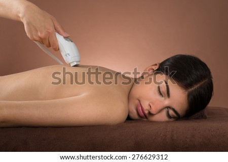 Close-up Of Young Woman With Eyes Closed Receiving Epilation Laser Treatment - stock photo