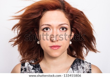 Close up of young woman with thick high volume brown hair - stock photo