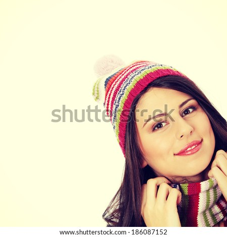 Close up of young woman with winter cap smiling at the camera - stock photo