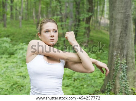 Close up of young women stretching  - stock photo