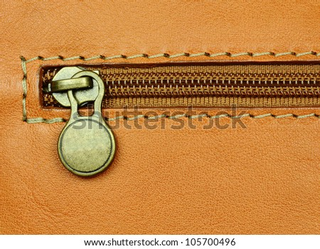 close-up of zip fastening on leather luggage - stock photo
